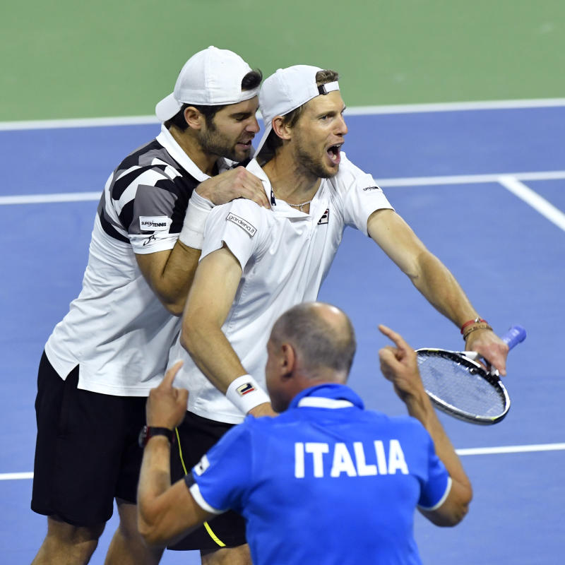 Tennis - Italy save match point to stay alive against Belgium