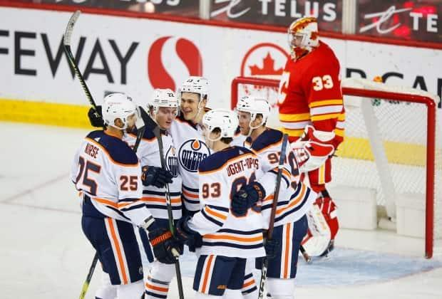 Edmonton Oilers players are seen celebrating a goal against the Calgary Flames on Friday. The Flames suffered back-to-back defeats against the Oilers, including a 7-1 rout on Saturday night.