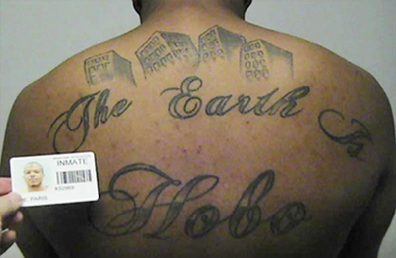 """FILE - This undated file photo in a court filing provided by the United States Attorney's office in Chicago, shows Paris Poe's back tattoo that reads """"The Earth Is Our Turf"""", and """"Hobo."""" A federal judge has sentenced Poe, a hit man with a Chicago street gang to life in prison in one of the city's largest gang cases in years on Friday, Aug. 11, 2017. U.S. District Judge John Tharp judge noted that Poe killed two government witnesses planning to testify against his gang, the Hobos. (United States Attorney's office in Chicago via AP, File)"""