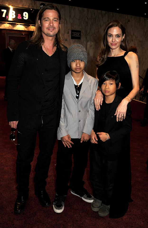 LONDON, ENGLAND - JUNE 02:  (EMBARGOED FOR PUBLICATION IN UK TABLOID NEWSPAPERS UNTIL 48 HOURS AFTER CREATE DATE AND TIME. MANDATORY CREDIT PHOTO BY DAVE M. BENETT/GETTY IMAGES REQUIRED)  (L to R) Brad Pitt, Maddox Jolie-Pitt, Pax Jolie-Pitt and Angelina Jolie attend the World Premiere of 'World War Z' at The Empire Cinema Leicester Square on June 2, 2013 in London, England.  (Photo by Dave M. Benett/WireImage for Paramount)