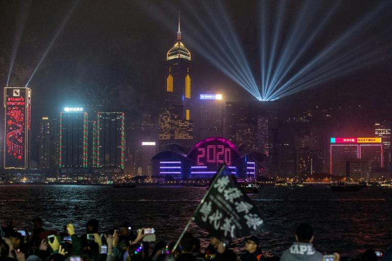 Pro-democracy protesters and revellers gather in Hong Kong to welcome in 2020