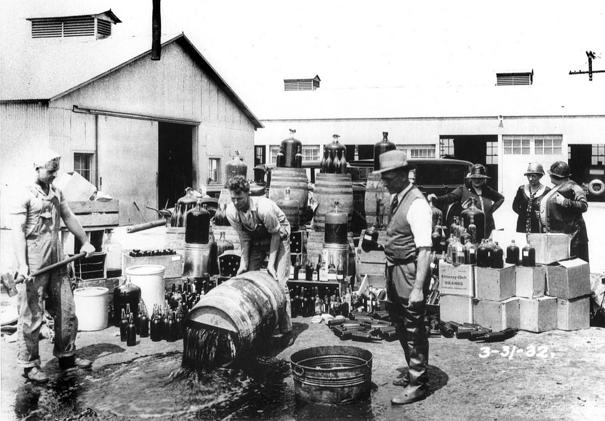 """Today, """"bootlegging"""" is by no means an official term—but it's still very much illegal. <a rel=""""nofollow"""" href=""""https://www.law.cornell.edu/uscode/text/17/1101"""">U.S. Code</a> just refers to is as """"unauthorized fixation and trafficking in sound recordings."""" So, why do we colloquially refer to """"unauthorized trafficking"""" as """"bootlegging?""""  Well, the answer is a boozy doozy: Back in Prohibition-era American, alcohol smugglers would literally hide bottles of liquor in their boots, flush against the leg. That's about as """"unauthorized trafficking"""" as you can get. When alcohol became legal again, the term """"bootlegging"""" was applied to other goods. And, today, we apply it things you cannot literally bootleg. (Can you smuggle a digital file in your shoes? Yeah—thought so.)"""