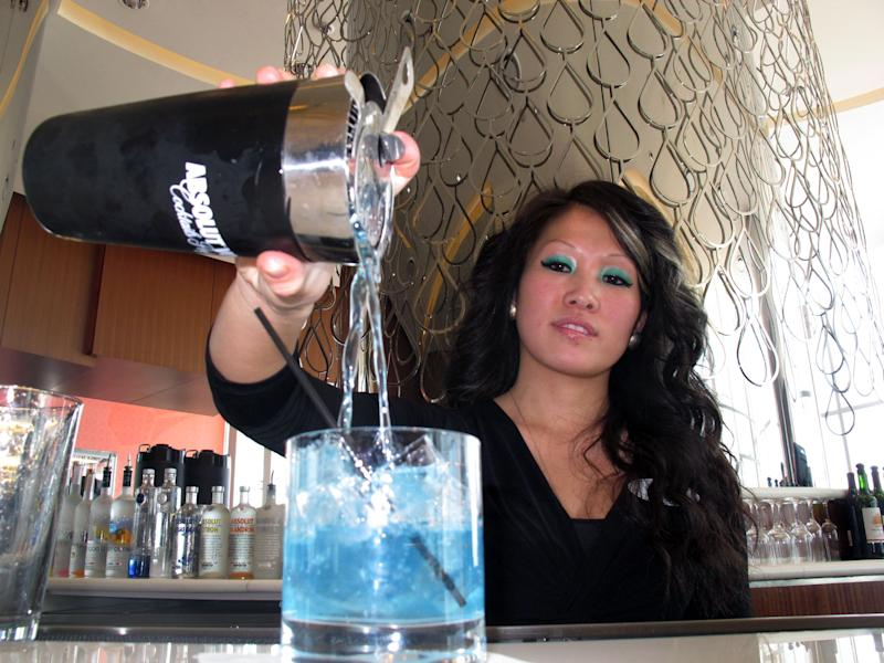 In this Sunday, April 8, 2013 photo, Mary Ma, a bartender at Revel, Atlantic City, N.J.'s newest casino, pours a drink at one of the casino's bars. The Institute for Supply Management said Friday, May 3, 2013, that its index of non-manufacturing activity fell to 53.1 in April from 54.4 in March. Any reading above 50 indicates expansion.  (AP Photo/Wayne Parry)