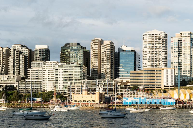 Yachts and sailboats in the Lavender bay in Sydey harbour with view of the Luna Park and North Sydney condominium tower in Sydney in Australia largest city (Yachts and sailboats in the Lavender bay in Sydey harbour with view of the Luna Park and North