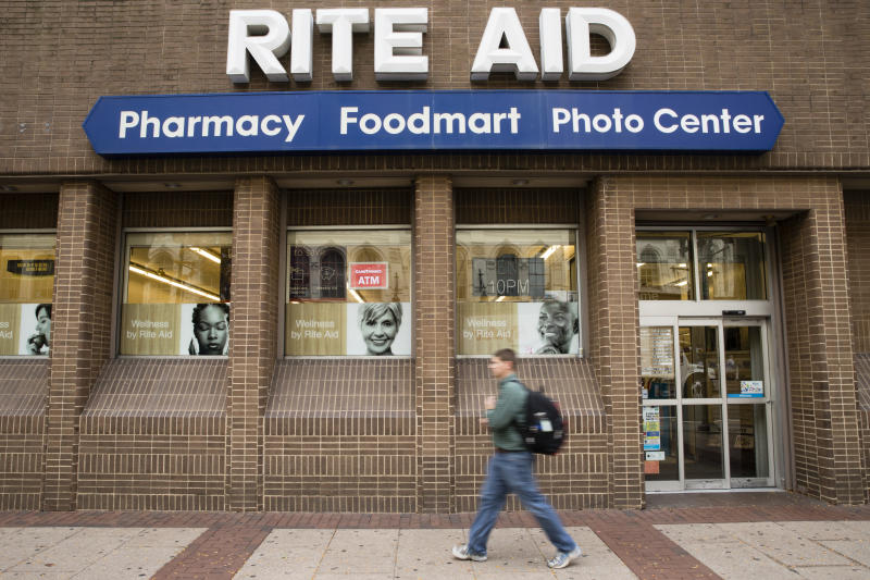 """FILE - In this Oct. 21, 2016, photo, a man walks past a Rite Aid in Philadelphia. Pharmacy chains, including Rite Aid, are fighting claims that they're to blame for the opioid crisis in two Ohio counties. The Monday, Jan. 6, 2020, filings asked U.S. district Court Judge Dan Polster to find in the pharmacies' favor and reject claims brought by Summit and Cuyahoga counties, home to Akron and Cleveland respectively, that argue that chains such as CVS, Rite Aid and Walgreens contributed to the problem by filling an """"excessive volume"""" of opioid prescriptions.  (AP Photo/Matt Rourke, File)"""