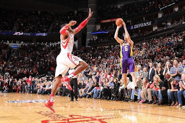 HOUSTON, TX - NOVEMBER 7: Steve Blake #5 of the Los Angeles Lakers hits the game winning 3 pointer against the Houston Rockets on November 7, 2013 at the Toyota Center in Houston, Texas. (Photo by Bill Baptist/NBAE via Getty Images)