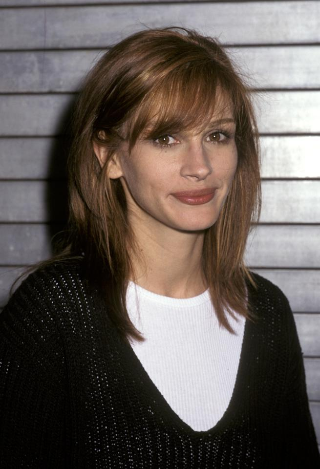 <p>Wearing her auburn brown locks shoulder length with side swept bangs and a mauve lip, Roberts poses at the At Industria Superstudio. 1995.</p>
