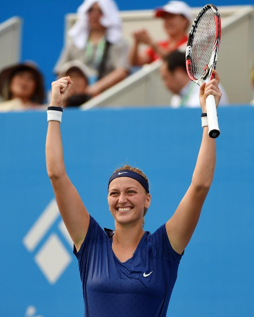Petra Kvitova of the Czech Republic celebrates her win over Eugenie Bouchard of Canada in the final of the Wuhan Open tennis tournament, in China's Hubei province, on September 27, 2014 (AFP Photo/Greg Baker)