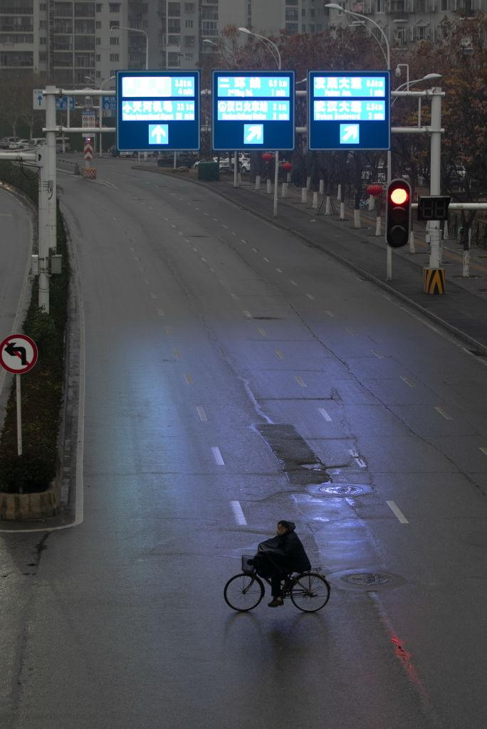 One major road was completely empty as a lone cyclist crosses. Source: Getty