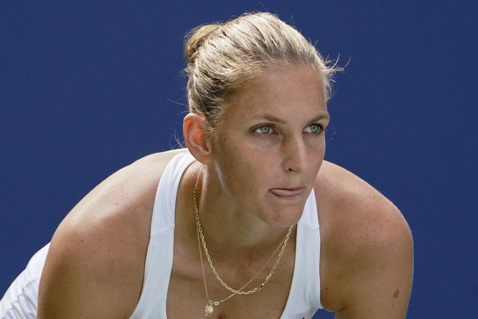 Karolina Pliskova, of the Czech Republic, prepares for a serve from Catherine McNally, of the United States, during the first round of the US Open tennis championships, Tuesday, Aug. 31, 2021, in New York. (AP Photo/John Minchillo)