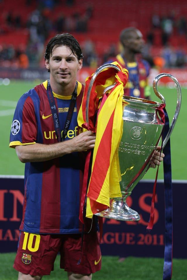 Lionel Messi lifts the Champions League trophy in 2011