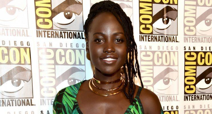 Lupita Nyong'o shows off cool hair in plunging jumpsuit