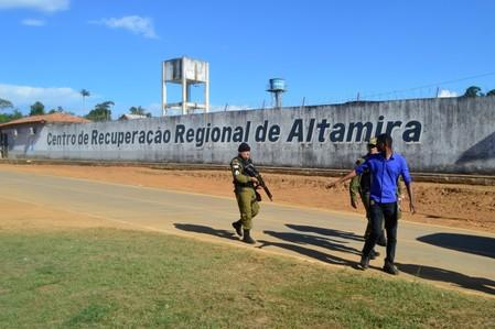 Police patrol in front of a prison after a riot, in the city of Altamira