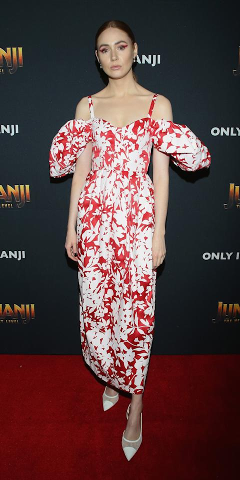 "<p>Karen Gillan wore a beautiful <a href=""http://www.anrdoezrs.net/links/7799179/type/dlg/sid/IS%2CKarenGillan%2Canesta%2C%2CIMA%2C3500336%2C201911%2CI/https://www.mytheresa.com/en-us/rosie-assoulin-off-the-shoulder-cotton-dress-1344443.html"" target=""_blank"">Rosie Assoulin</a> dress with white pumps while promoting the new <em>Jumanji: The Next Level </em>movie.</p>"