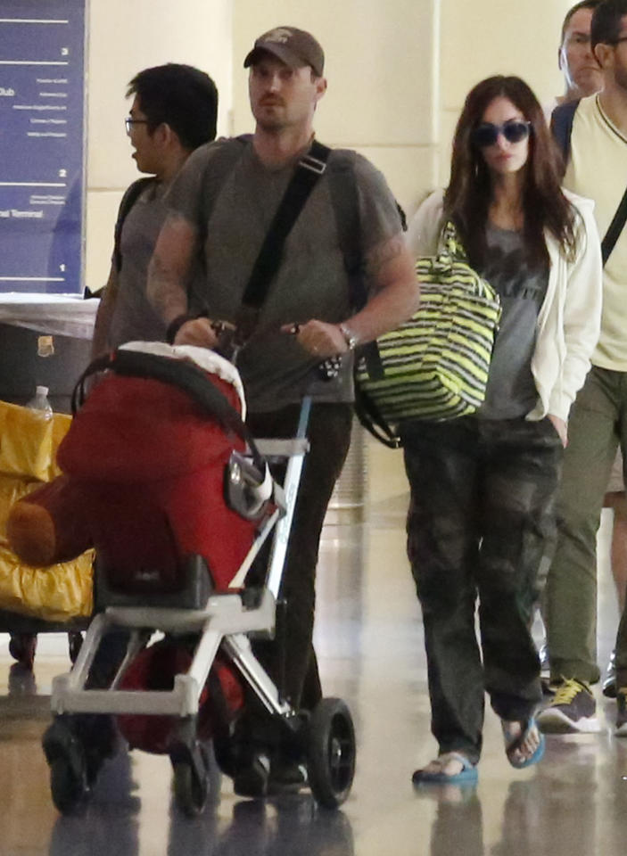 How much earlier do you think Brian Austin Green and his expectant wife, Megan Fox, have to get to the airport to catch a flight now that 10-month-old baby Noah is in the picture? It's only going to get worse when Fox delivers their second child later this year... (8/3/2013)