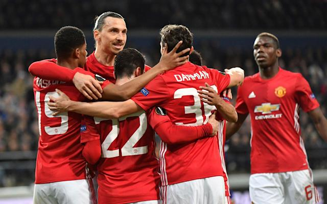 <span>Manchester United players congratulate Mkhitaryan, who has scored five times in the competition</span> <span>Credit: AP </span>