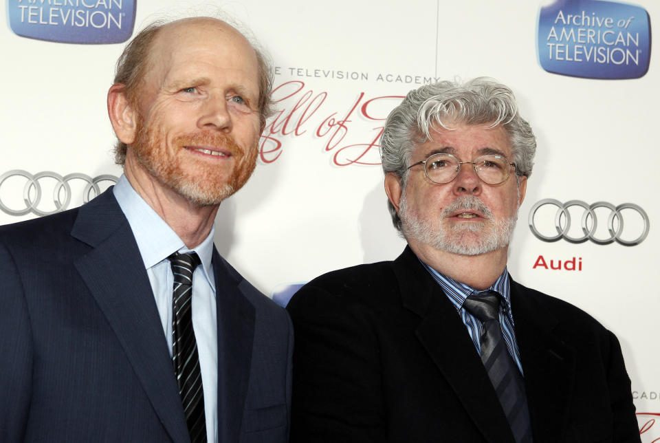 Director and actor Ron Howard (L) Hall of Fame inductees, poses with fellow director George Lucas at the Academy of Television Arts & Sciences 22nd annual Hall of Fame gala in Beverly Hills, California March 11, 2013. REUTERS/Fred Prouser (UNITED STATES - Tags: ENTERTAINMENT)