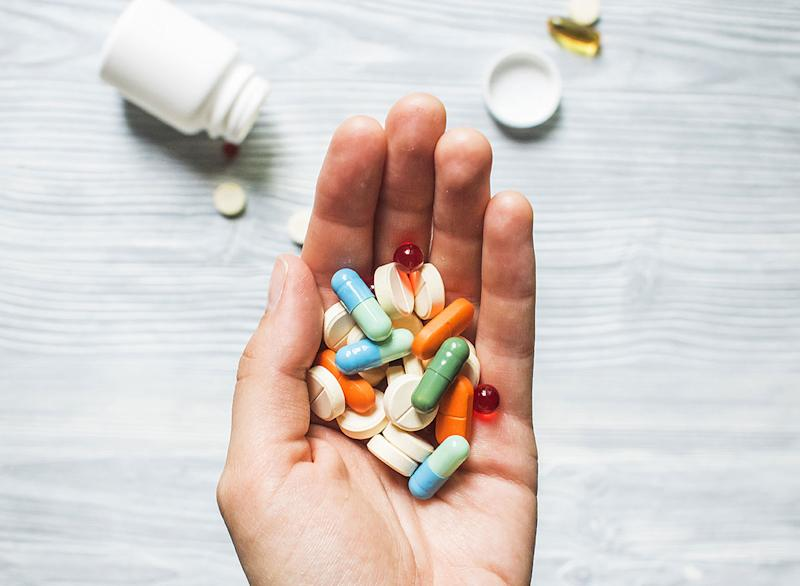 Colorful pills and medicine in the hand