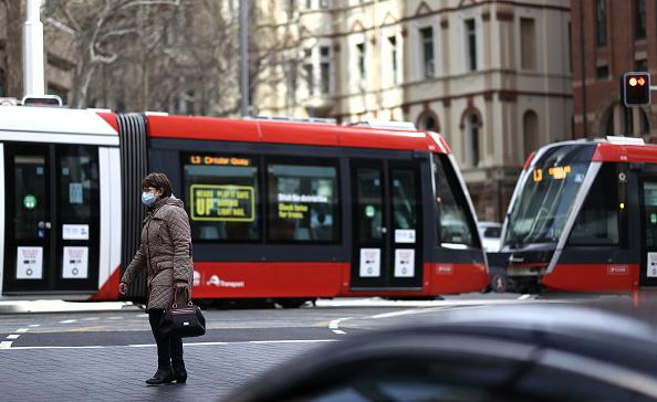People are seen wearing face masks in Sydney CBD.
