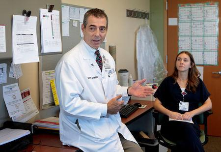 Dr. David Steinberg, Chief of Staff, Saint Joseph Mercy Health System chats with staff at Saint Joseph Mercy hospital in Ypsilanti, Michigan, U.S., August 23, 2017. Picture taken August 23, 2017. REUTERS/Rebecca Cook