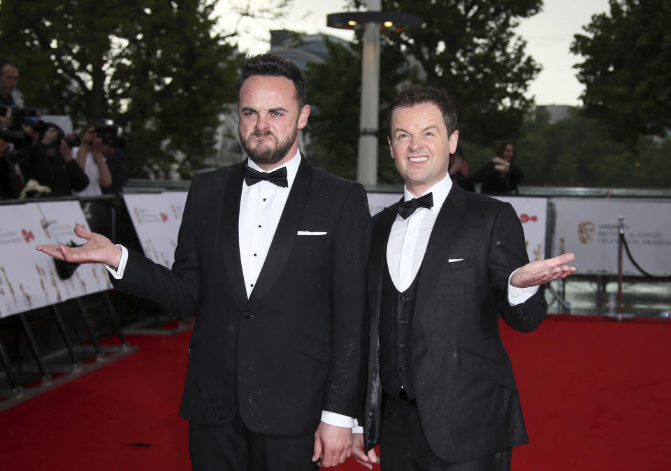 TV presenters Ant and Dec pose for photographers in the rain, upon arrival to the British Academy Television Awards at the Royal Festival Hall in London, Sunday, May 14, 2017. (Photo by Joel Ryan/Invision/AP)