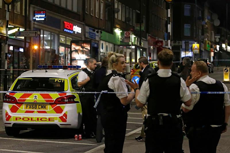 Police standing guard at a cordon in Wembley after a man was stabbed in Preston Road (NIGEL HOWARD ©)