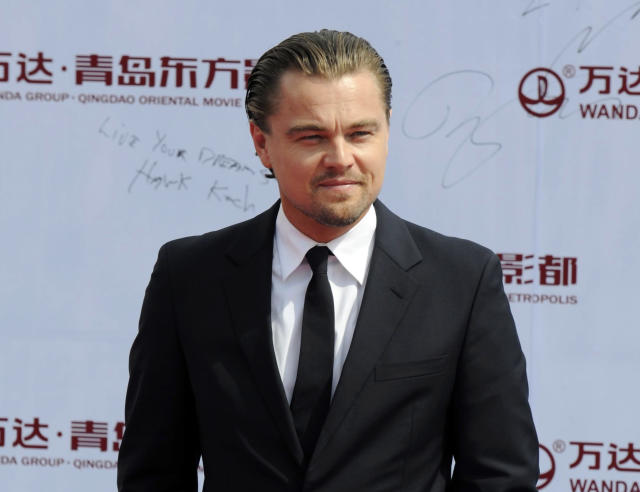 """FILE - This Sept. 22, 2013 file photo shows actor Leonardo DiCaprio at the launching ceremony of Qingdao Oriental Movie """"Metropolis"""" in Qingdao in east China's Shandong province. Venturi Automobiles announced Monday, Dec. 9, 2013, a joint venture with award-winning actor and environmental activist Leonardo DiCaprio to enter a team in the new FIA Formula E Championship - the world's first fully-electric race series beginning in September 2014. (AP Photo, File)"""
