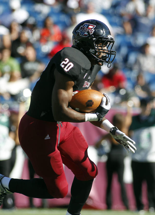 Massachusetts running back Lorenzo Woodley (20) runs against Northern Illinois during the first half of an NCAA football game in Foxborough, Mass., Saturday, Nov. 2, 2013. (AP Photo/Stew Milne)