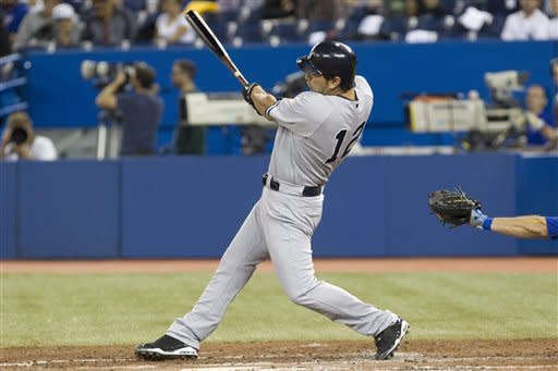 New York Yankees Eric Chavez hits a solo homer off Toronto Blue Jays Henderson Alvarez during the third inning ofa baseball game in Toronto on Sunday, Sept. 30, 2012. (AP Photo/The Canadian Press, Chris Young)