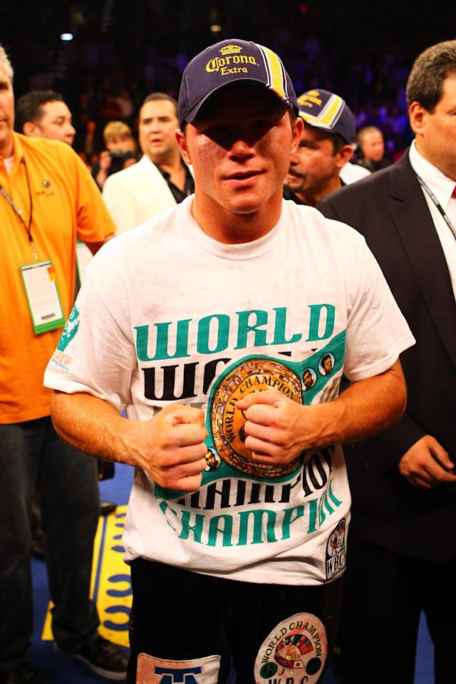 LAS VEGAS, NV - MAY 05: Canelo Alvarez celebrates his unanimous decision victory against Shane Mosley during their WBC super welterweight title fight at the MGM Grand Garden Arena on May 5, 2012 in Las Vegas, Nevada. (Photo by Al Bello/Getty Images)