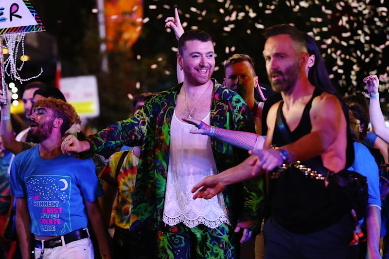 Sam Smith was seen before their performance enjoying the parade. (Getty Images)