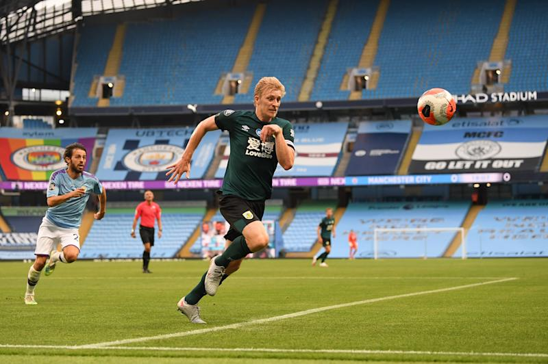 Burnley's English defender Ben Mee chases the ball during the English Premier League football match between Manchester City and Burnley at the Etihad Stadium in Manchester, north west England, on June 22, 2020. (Photo by Michael Regan / POOL / AFP) / RESTRICTED TO EDITORIAL USE. No use with unauthorized audio, video, data, fixture lists, club/league logos or 'live' services. Online in-match use limited to 120 images. An additional 40 images may be used in extra time. No video emulation. Social media in-match use limited to 120 images. An additional 40 images may be used in extra time. No use in betting publications, games or single club/league/player publications. / (Photo by MICHAEL REGAN/POOL/AFP via Getty Images)