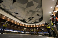 Visitors view the home hockey locker room at Climate Pledge Arena during a media tour of the facility, Monday, July 12, 2021, in Seattle. The arena will be the home of the NHL hockey team Seattle Kraken and the WNBA Seattle Storm basketball team as well as hosting concerts and other performing arts events. (AP Photo/Ted S. Warren)