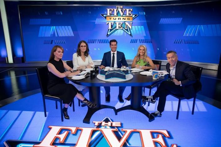 NEW YORK, NY - JULY 09, 2021: Dagen McDowell left, and Jessica Tarlov, second from left, both guest hosts and Fox News co-hosts of 'The Five,' Jesse Watters, center, Dana Perino, second from right, and Greg Gutfeld, right, pose for a photo on the set of the program at Fox News headquarters on July 09, 2021 in New York City. (PHOTOGRAPH BY MICHAEL NAGLE / FOR THE TIMES)