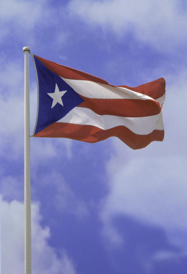 A police officer is under investigation for not helping a woman who was harassed for wearing a shirt with a Puerto Rican flag. (Photo: Getty Images)
