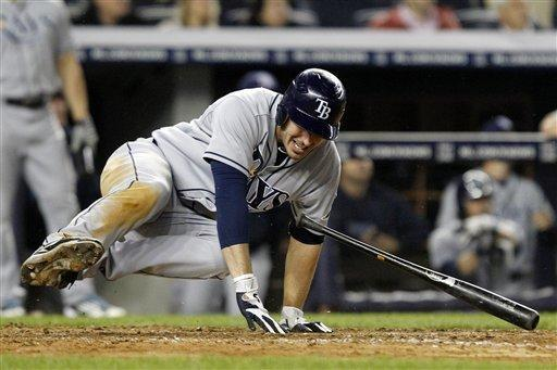 Tampa Bay Rays' Matt Joyce falls after twisting his left ankle while watching his ninth-inning, three-run home run against the New York Yankees in their baseball game at Yankee Stadium in New York, Wednesday, May 9, 2012. The Rays won 4-1. (AP Photo/Kathy Willens)