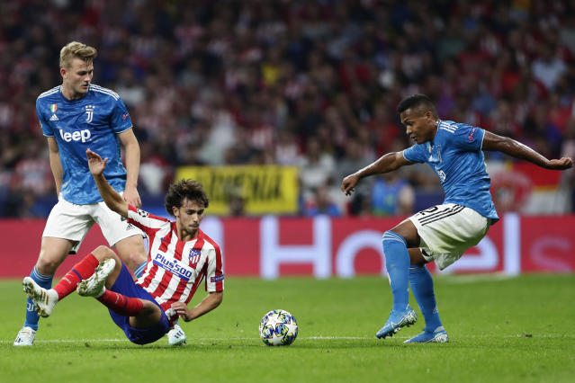 Atletico Madrid's Joao Felix fights for the ball against Juventus' Matthijs de Ligt, left, and Juventus' Alex Sandro, right, during the Champions League Group D soccer match between Atletico Madrid and Juventus at Wanda Metropolitano stadium in Madrid, Spain, Wednesday, Sept. 18, 2019. (AP Photo/Manu Fernandez)
