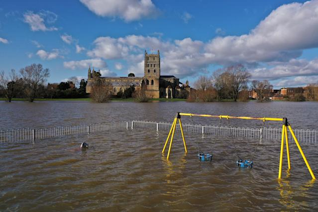 Tewkesbury Abbey and a children's playground at the confluence of the Rivers Severn and Avon is surrounded by flood waters (Getty)