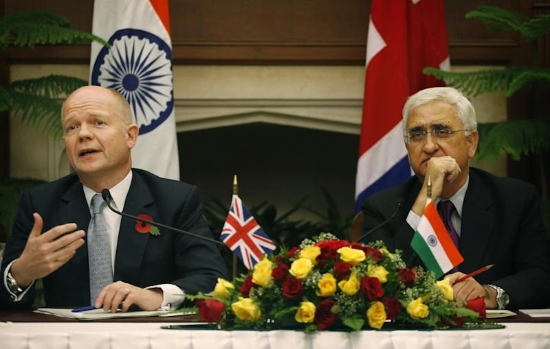 Indian Foreign Minister Salman Khurshid, right, and British Foreign Secretary William Hague, address a joint presser after a meeting in New Delhi, India, Thursday, Nov. 8, 2012. Hague is meeting with top officials in the Indian capital to discuss ways to increase trade and investment and to tackle other issues, including terrorism, cyber security and defense. (AP Photo/Saurabh Das)