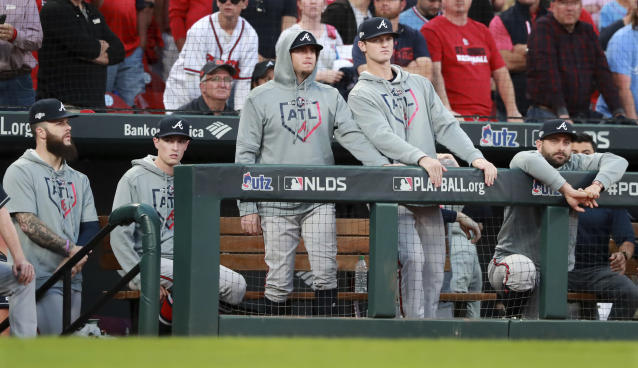 Atlanta Braves players watch from the dugout as they fall to the St. Louis Cardinals in the 10th inning of Game 4 of a baseball National League Division Series, Monday, Oct. 7, 2019, in St. Louis. (Curtis Compton/Atlanta Journal-Constitution via AP)