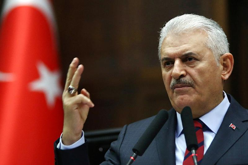 Turkish Prime Minister and leader of Turkey's ruling Justice and Development Party (AKP) Binali Yildirim addresses the AKP group meeting at the Grand National Assembly of Turkey in Ankara on November 29, 2016 (AFP Photo/ADEM ALTAN)