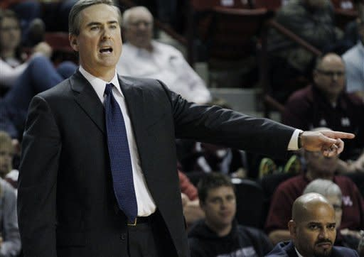 Mississippi State basketball coach Rick Stansbury calls out to his players in the second half of their NCAA college basketball game against Utah State in Starkville, Miss., Saturday, Dec. 31, 2011. Mississippi State won 66-64. (AP Photo/Rogelio V. Solis)
