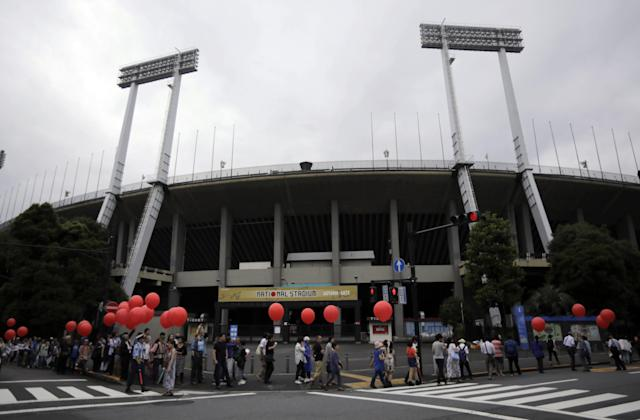 Protesters march around Tokyo's National Stadium Saturday, July 5, 2014. The group of about 500 protesters demonstrated against plans to destroy the 56-year-old facility and replace it with a colossal, futuristic structure for the 2020 Summer Olympics. (AP Photo/Eugene Hoshiko)