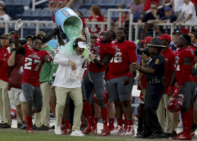 Florida Atlantic head coach Lane Kiffin is doused as his team celebrates defeating UAB in an NCAA college football game for the Conference USA championship, Saturday, Dec. 7, 2019, in Boca Raton, Fla. (Mike Stocker/South Florida Sun-Sentinel via AP)