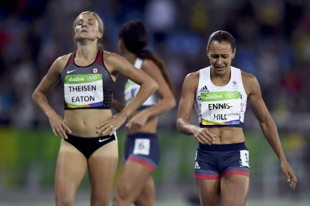 2016 Rio Olympics - Athletics - Final - Women's Heptathlon 800m - Olympic Stadium - Rio de Janeiro, Brazil - 13/08/2016. Jessica Ennis-Hill (GBR) of Britain and Brianne Theisen-Eaton (CAN) of Canada react after the race REUTERS/Dylan Martinez FOR EDITORIAL USE ONLY. NOT FOR SALE FOR MARKETING OR ADVERTISING CAMPAIGNS.