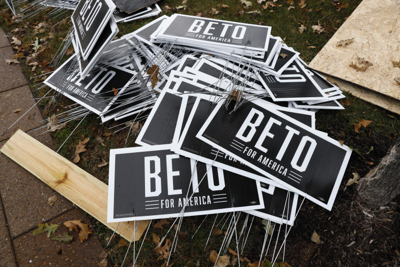 Campaign signs for Democratic presidential candidate Beto O'Rourke sit piled up before the Iowa Democratic Party's Liberty and Justice Celebration, Friday, Nov. 1, 2019, in Des Moines, Iowa. O'Rourke told his supporters that he was ending his presidential campaign. (AP Photo/Charlie Neibergall)