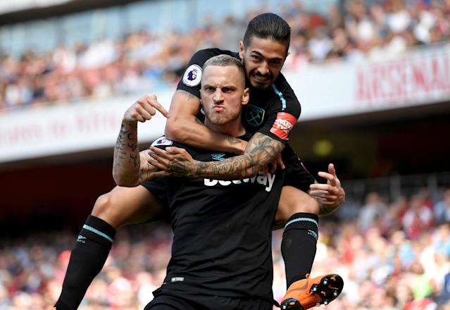 """Soccer Football - Premier League - Arsenal v West Ham United - Emirates Stadium, London, Britain - April 22, 2018 West Ham United's Marko Arnautovic celebrates with Manuel Lanzini after scoring their first goal REUTERS/Toby Melville EDITORIAL USE ONLY. No use with unauthorized audio, video, data, fixture lists, club/league logos or """"live"""" services. Online in-match use limited to 75 images, no video emulation. No use in betting, games or single club/league/player publications. Please contact your account representative for further details. TPX IMAGES OF THE DAY"""