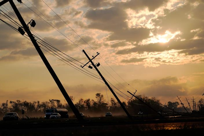 File: Downed power lines slump over a road in the aftermath of Hurricane Ida (AP)