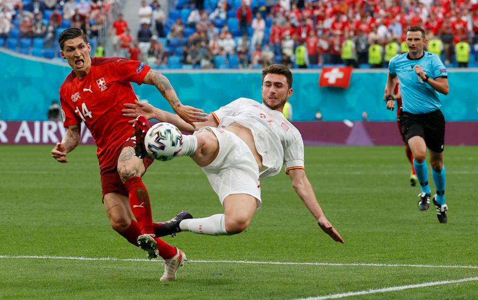 SAINT PETERSBURG, RUSSIA - JULY 02: Aymeric Laporte of Spain clears the ball whilst under pressure from Steven Zuber of Switzerland during the UEFA Euro 2020 Championship Quarter-final match between Switzerland and Spain at Saint Petersburg Stadium on July 02, 2021 in Saint Petersburg, Russia. (Photo by Anatoly Maltsev - Pool/Getty Images)