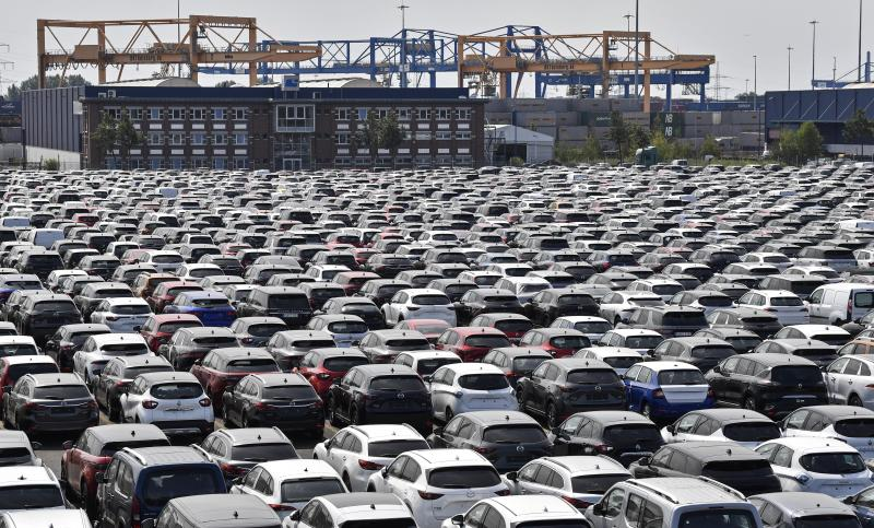 New cars are stored at the 'logport' (logistic port) in Duisburg, Germany, Wednesday, June 3, 2020. The car industry is expecting help by the German government because ot the economy crisis due to the coronavirus pandemic. (AP Photo/Martin Meissner)